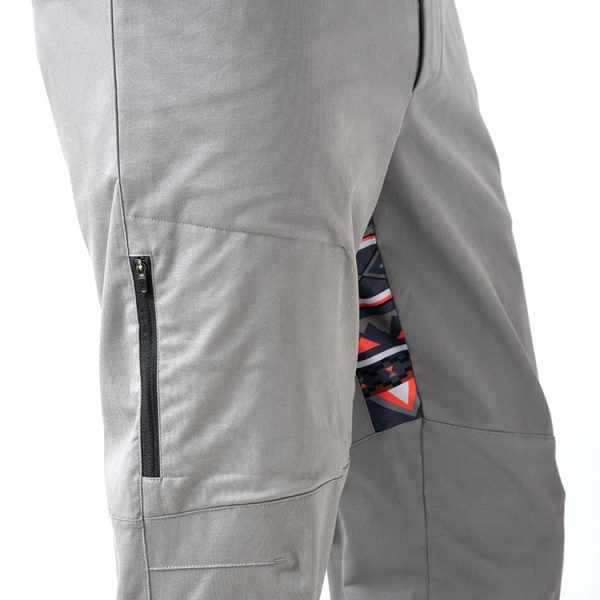 Detail of zipper pocket - with zipper that locks in position and view of stretch panel