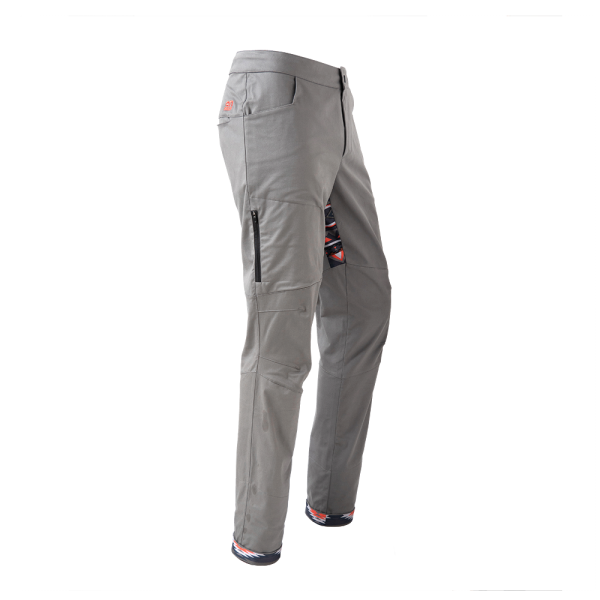 Rock pants in gray for climbing with stretch panel in native red and zip pocket above knee