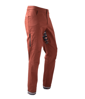 Rock pants in rust red for climbing with stretch panel in native red and zip pocket above knee