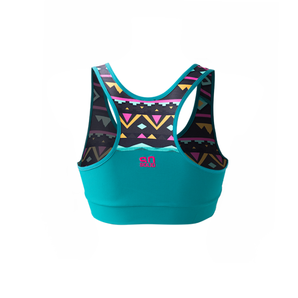 SO SOLID back view of reversible sports bra in turquoise with partial native pattern in gray with pink details - made out of recycled nylon